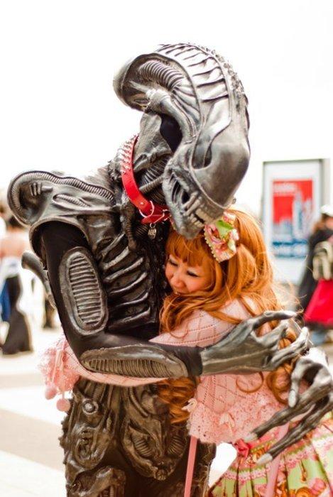 Alien hugging a human